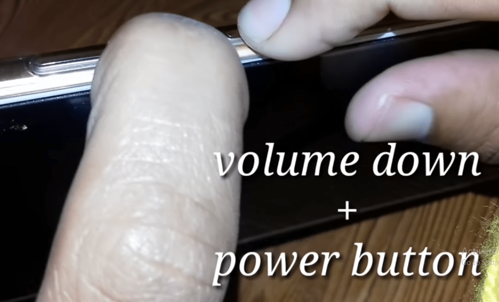 press volume down + power key